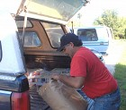 Truck of Food Bank Boxes Unloaded at St. George's