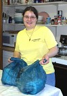 Young Volunteer Helps Carry Out Bags of Fresh Produce